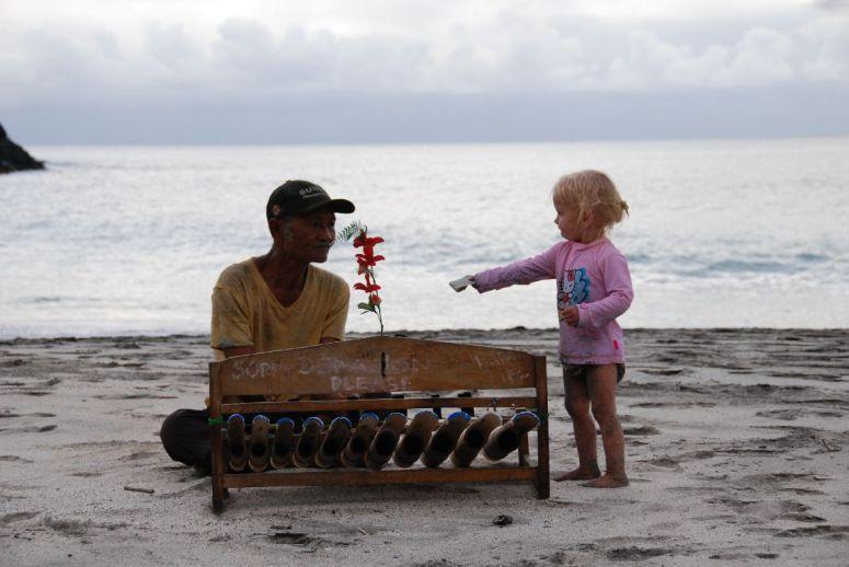 musiker på strand